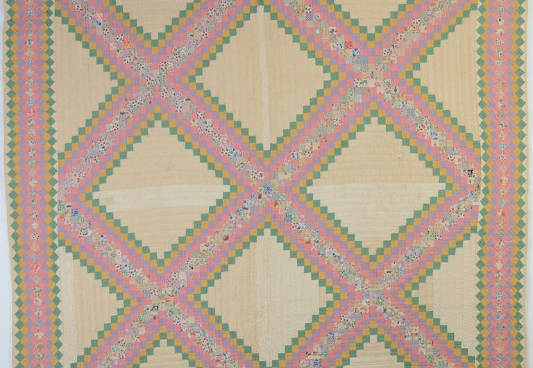 This is a very densely pieced version of an Irish Chain Quilt. It was beautifully planned with printed fabrics in the center of each band and solids on either side. Continuation of the same pattern throughout the border is a wonderful element. The