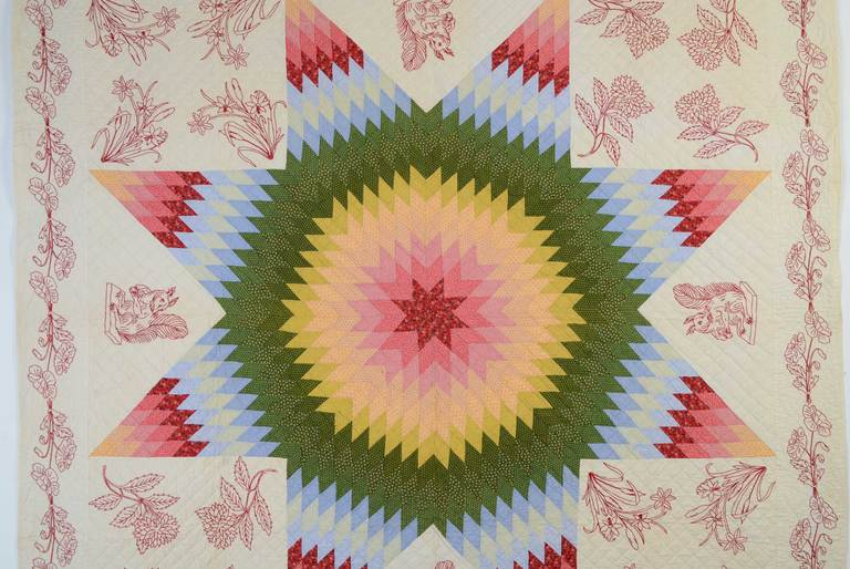 This Lone Star Quilt (aka Star of Bethlehem or Texas Star) combines with embroidery in what may be a unique pairing. The two opposing corners have different flowers and a third variety along the border. Most unusual of all are the four squirrels.The