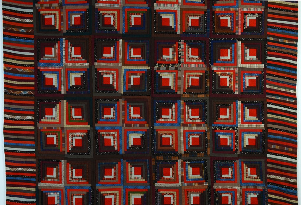 This Light and Dark Log Cabin quilt is a particularly well done example of a classic pattern. Many log cabins are not actually quilted and this one is, as can easily be seen in the red centers. It is a popular belief that the frequently used red