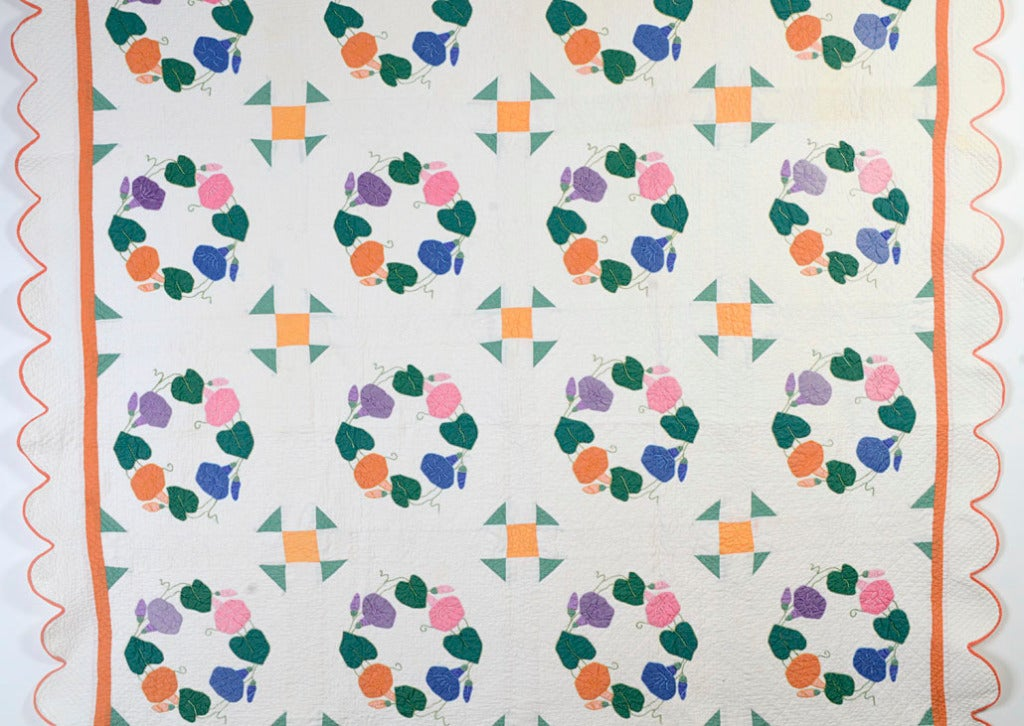 This Morning Glories quilt combines two traditional patterns that are rarely, if ever, seen together. The geometric Monkey Wrench is an unusual, but effective, matching with the floral pattern. It is light and airy with lovely quilting and a