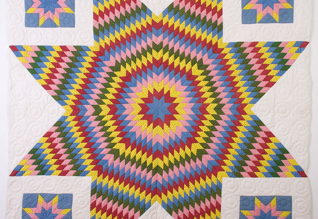 Dramatic Star of Bethlehem Quilt (aka Lone Star or Texas Star) with beautiful printed fabrics on a solid white ground.<br />