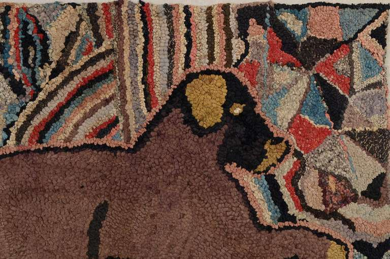 A vibrant kaleidoscopic background sets off this  charming reclining dog hooked rug.  The dog has whimsical yellow paws; ears and nose adding to his unique charm. The initials EG are probably those of the maker. Professionally mounted on a stretcher