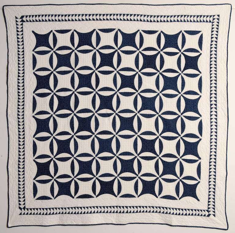 The classic Robbing Peter to Pay Paul (aka Lemon Peel) quilt pattern is enhanced by the small scale Flying Gees border. The angles of the border pattern are an interesting counterpoint to the curves of the primary one. The quilt is in pristine,