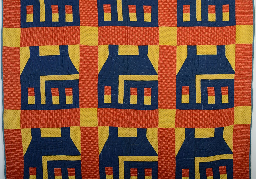 Vibrant Schoolhouse Quilt done with a combination of solid color and calico fabrics. Both the scale of the houses and the colors combine to make this a real eye popper. Sussex County, Delaware origin. Family name available to purchaser. Excellent