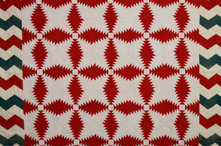 The combination of the Windmill Blades (aka Pineapple Log Cabin) quilt pattern with a Streak of Lightning border makes for a real eye dazzler. The use of solid color, rather than patterned fabrics, adds to the impact. Opposing corners are treated