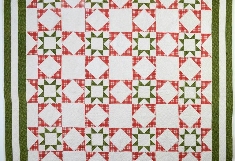 This Evening Stars Quilt is a lovely variation of a traditional pattern. Placing one star within another and placing the red stars abutting one another creates a variety of optical illusions and additional patterns. The quilt is from Gettysburg,