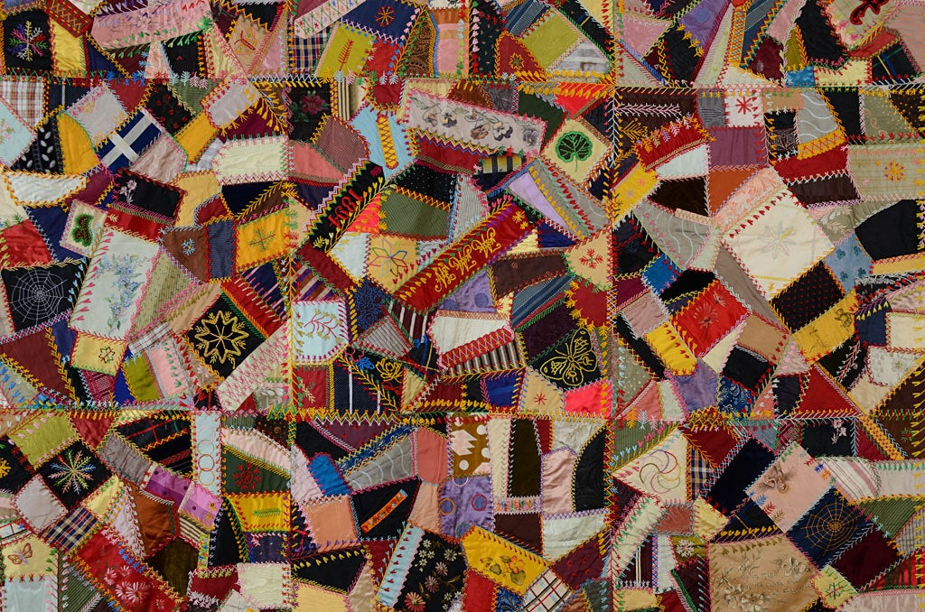 This lively Crazy Quilt has all the bells and whistles one expects in fancy quilts of this era. Embroidered motifs include butterflies; flowers; a spiderweb and fans. The written sentiments,legible in thumbnail photos, are quintessentially Victorian