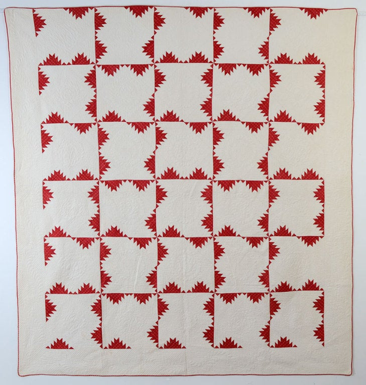 "This early Kansas Troubles Quilt is finely pieced and quilted. The white blocks are quilted with several different wreath and floral patterns. The border has an extremely graceful feather throughout. It is in excellent condition and measures 83"" x"