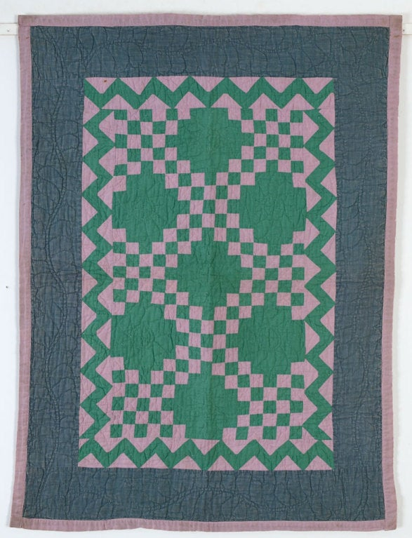 This Irish Chain Crib Quilt is a wonderful miniature quilt. The pieces are small and the quilted vine in the outer border is a nicely scaled down version of what one would expect in a full size quilt. The inner zigzag border is an ideal frame. The