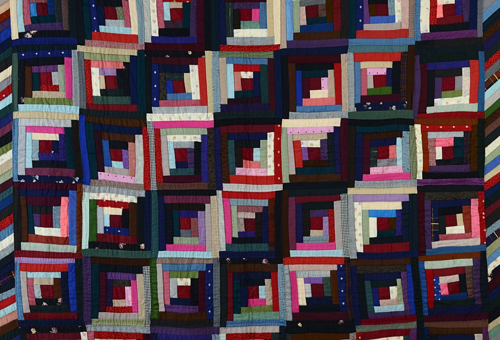 This Streak of Lightning Quilt displays the strong graphics for which Mennonite quilts are known. The piano key border creates a wonderful frame continuing the diagonal theme. It is from Lancaster County, Pennsylvania; made of wools; circa 1890.