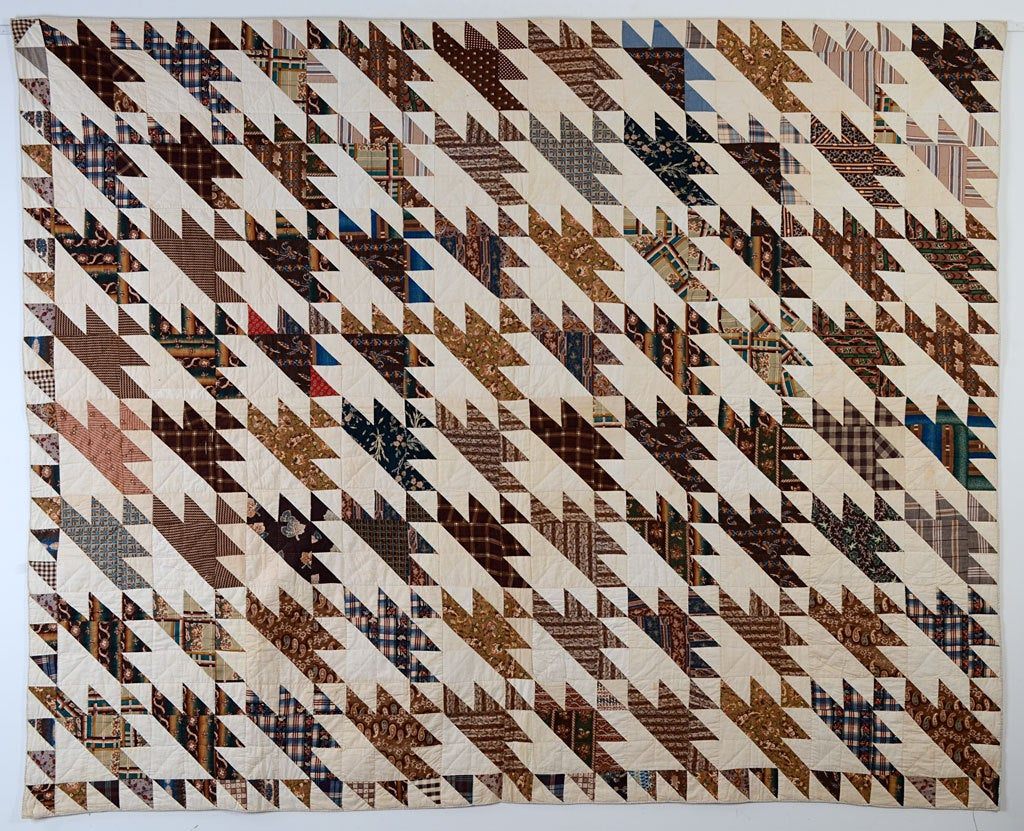 This Sawtooth Quilt pattern is made of large blocks of richly colored, early blue and brown fabrics. The triangle pattern of the pieced blocks is repeated in the quilting. The quilt is in excellent, unwashed condition. There is a water spot on the