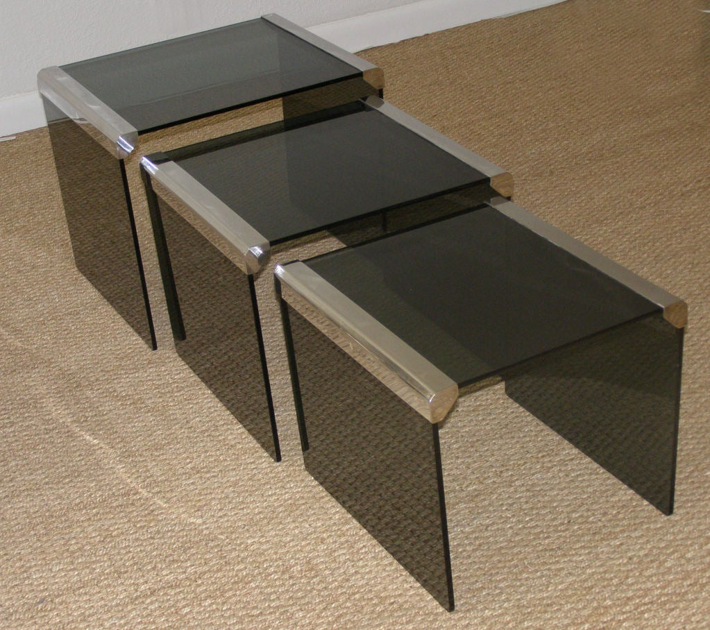 Set of three smoked acrylic and steel nesting tables at