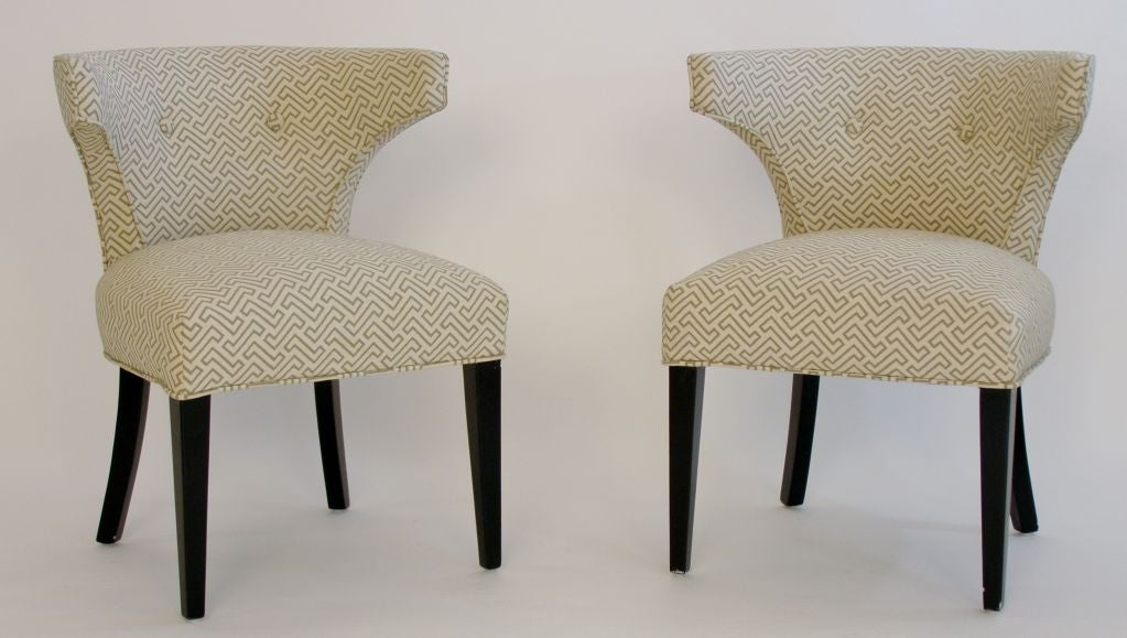 Elegant pair of klismos chairs finished in black lacquer and newly upholstered in a textured cotton fabric reminiscent of African textiles and Keith Haring designs. With comfortable wrapped backs, these chairs are as elegant today as when first