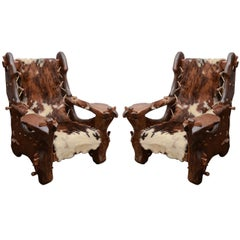 Pair of Pinewood and Cowhide Armchairs by Georges Charpentier
