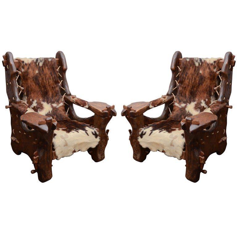Pair of Pinewood and Cowhide Armchairs by Georges Charpentier For Sale