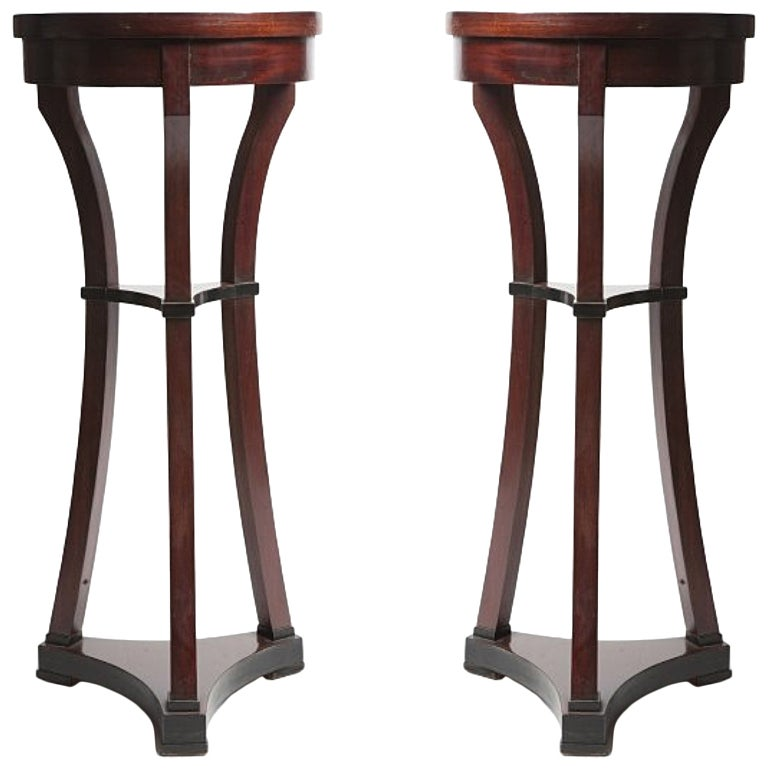 Pair of rare small round Russian Biedermeier side tables.