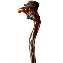 A Carved And Stained Wood Walking Stick.
