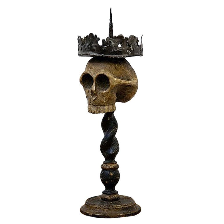 An important Memento Mori candle holder.
