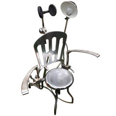 A Rare and Unusual Iron and Stainless Steel Dentist Armchair with Lamp