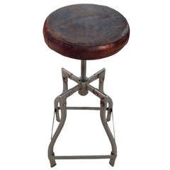 Adjustable Chromed Metal Stools With Padded Leather Top.