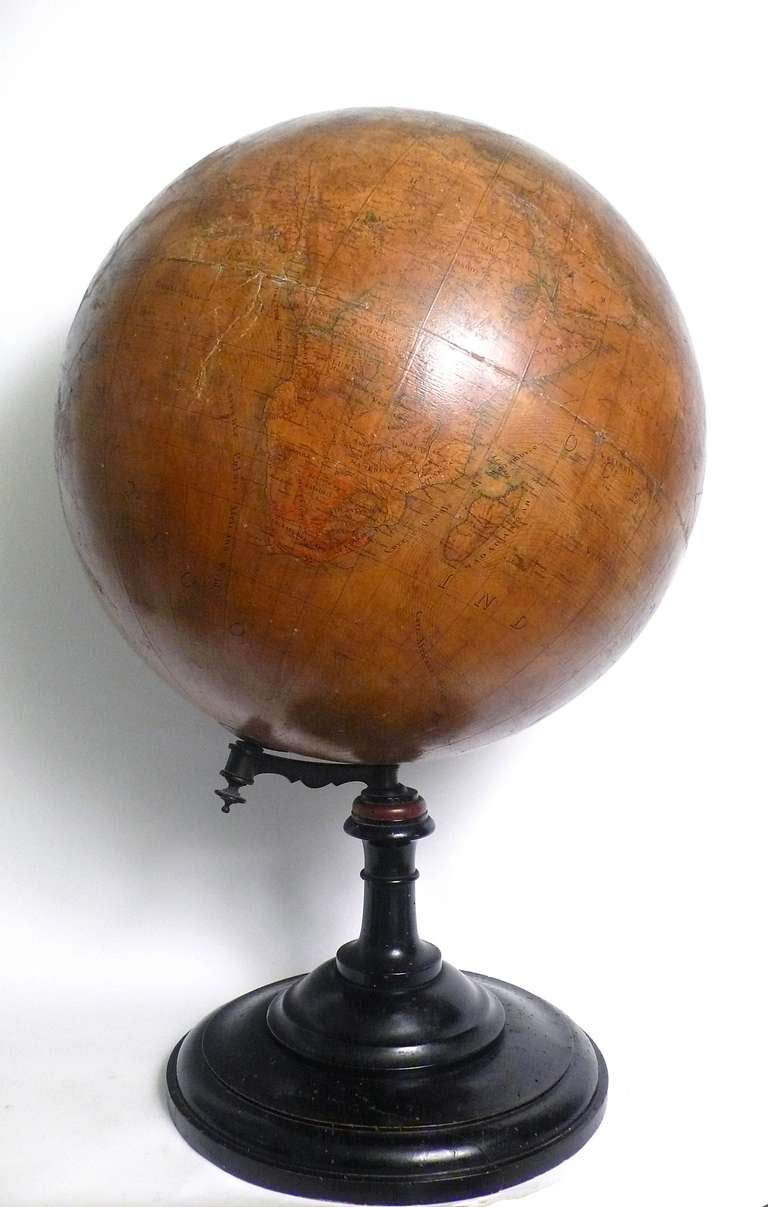 Large terrestrial papier machè globe, wooden pedestal. Signed E.Pini Milano, G. Gussoni publisher.