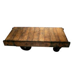 Wooden industrial cart with four metal wheels, Nutting Ind.