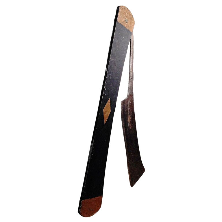 A folding straight edge razor trade sign.
