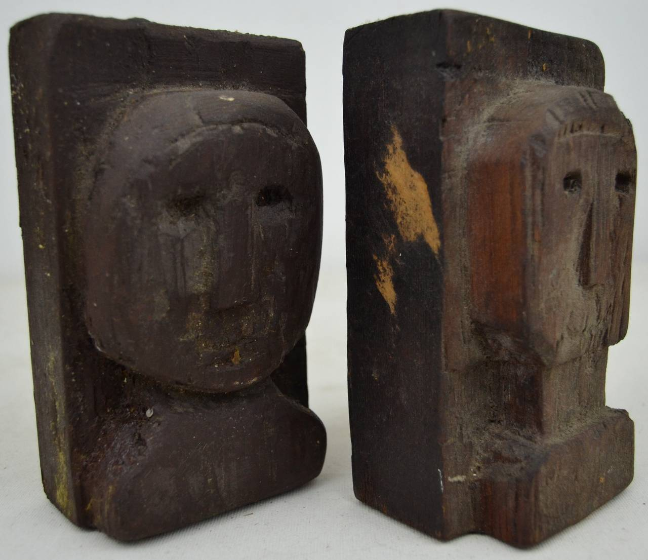 Pair of folky relief carved heads for sale at stdibs