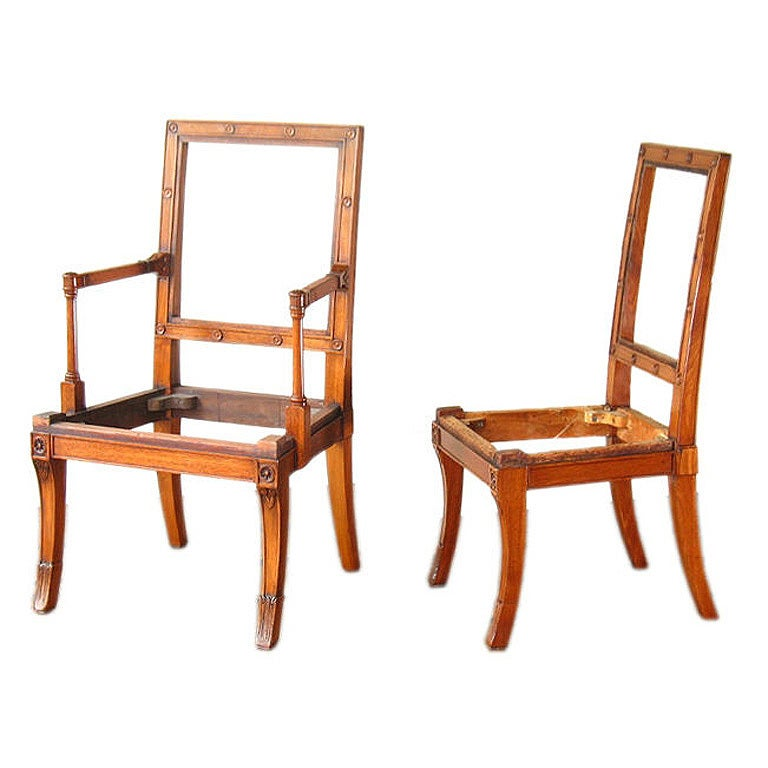 A Set Of Twelve Regency Revival Mahogany Dining Chairs At