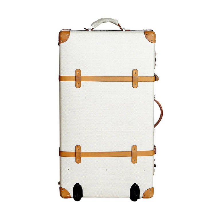 Guaranteed authentic Hermes suitcase with palladium hardware from the exclusive Faubourg Express line!  Limited Edition beige chevron pattern hard case with wheels. This suitcase is one of 3 that was available in the U.S. Interior features smooth