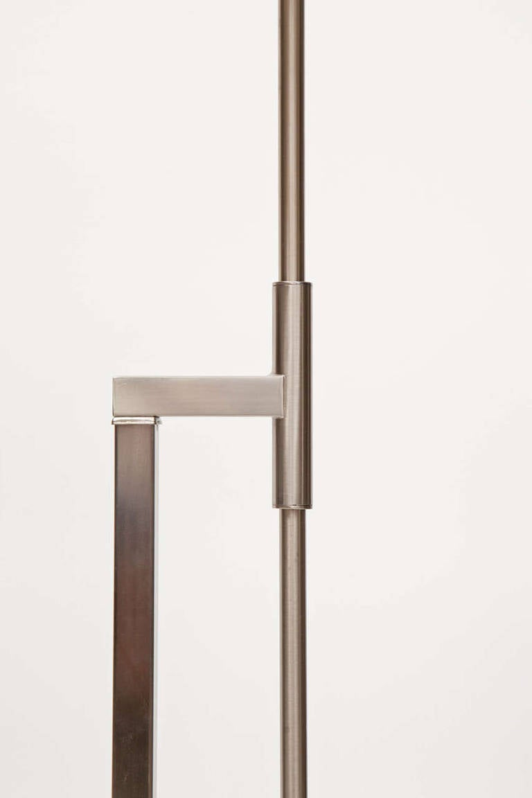 this pair of brushed steel adjustable height floor lamps by laurel is. Black Bedroom Furniture Sets. Home Design Ideas