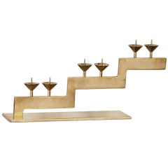 A Brass Tiered Candle Holder