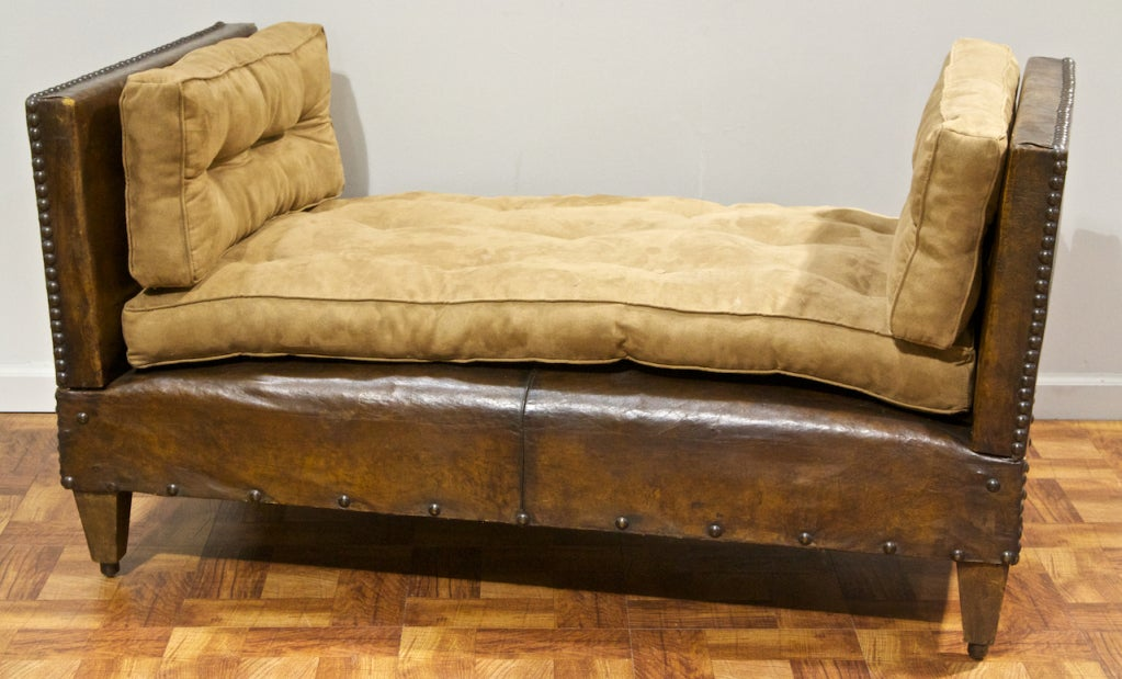 A vintage leather and suade bench adjusting to a daybed at for Leather daybed bench