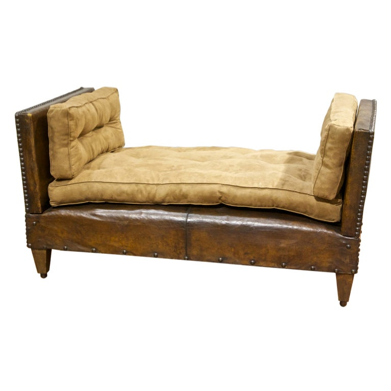 A vintage leather and suade bench adjusting to a daybed at Daybed bench