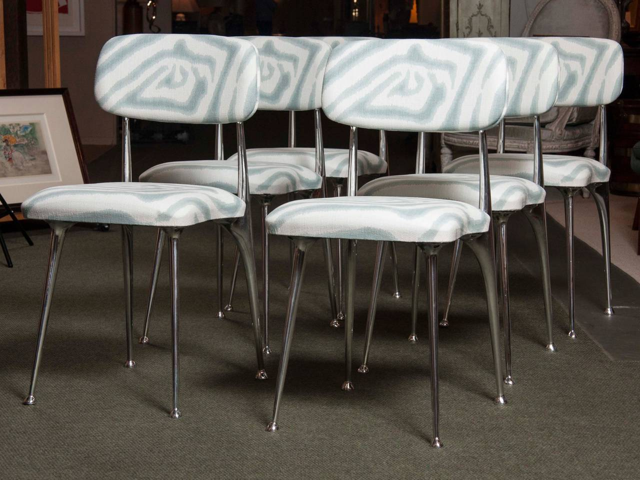 A beautifully upholstered set of mid-20th century, polished-aluminum, dining chairs by Shelby Williams. 6 upholstered in fabric shown.