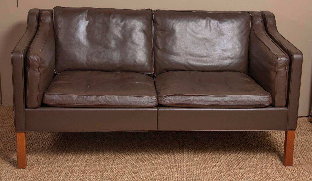 A leather sofa by Børge Mogensen for Frederica furniture with walnut legs. Made in Denmark in the 1960s.
