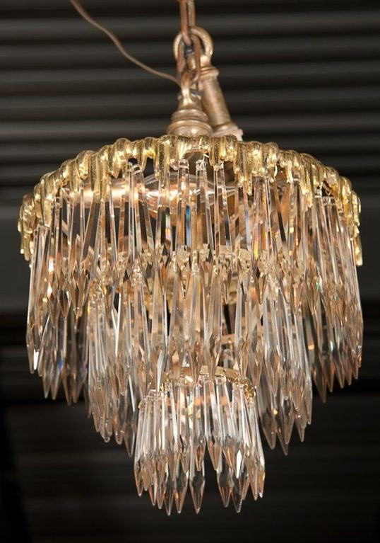 A wonderful set of two, French dore bronze, triple tier chandeliers retaining original mounts.