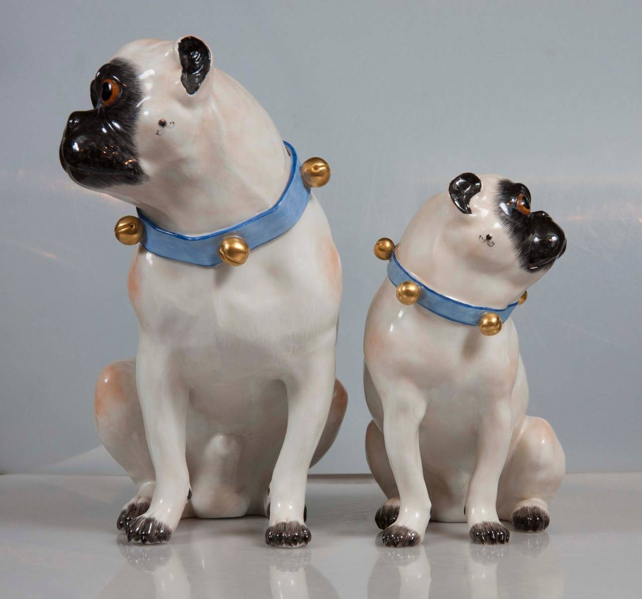 A pair of fully hallmarked Meissen mother and pug dogs, after J. J. Kandler.