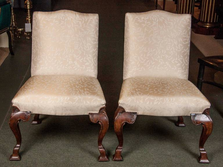A wonderful set of eight walnut dining chairs. Six of the eight chairs date back to George II and the other two have been recently carved. Expected restorations and repairs.