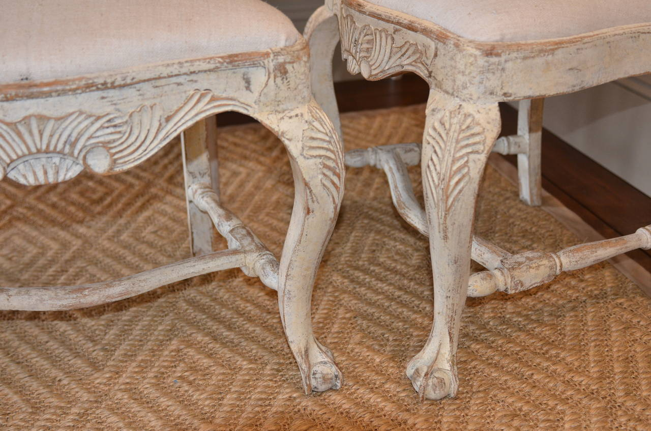 Set of six 19th century Swedish Rococo style chairs. Lovely carved apron and back, cabriole legs and ball and claw foot. Soft cream color. Newly upholstered in antique hemp.