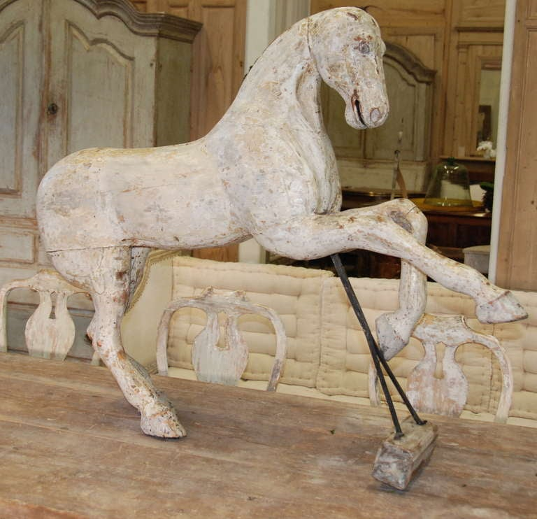 Fabulous wooden horse from Stockholm, Sweden. Beautiful face and stance. Scalped down to original white washed color.