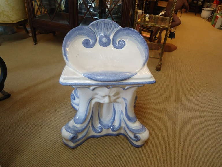 Vintage and very unusual blue and white Italian ceramic garden seat; shell motiffe on top, curved and comfy to sit on, quite heavy!