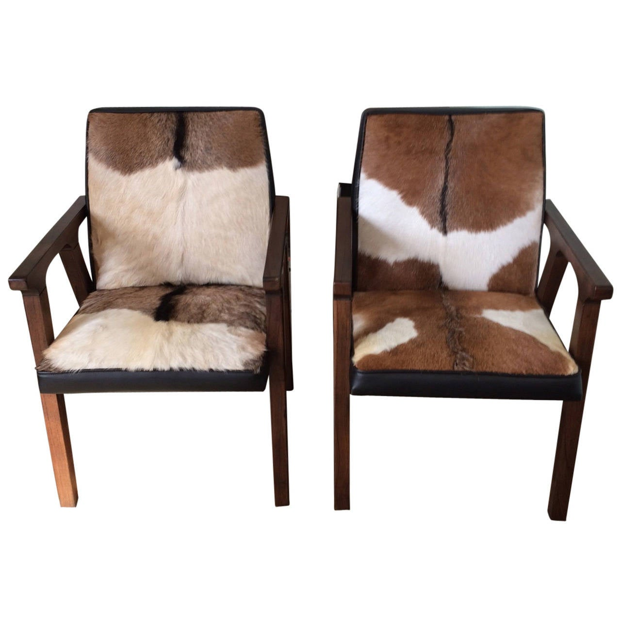 Pair of ultra cool cowhide and leather armchairs at 1stdibs for Cool armchairs