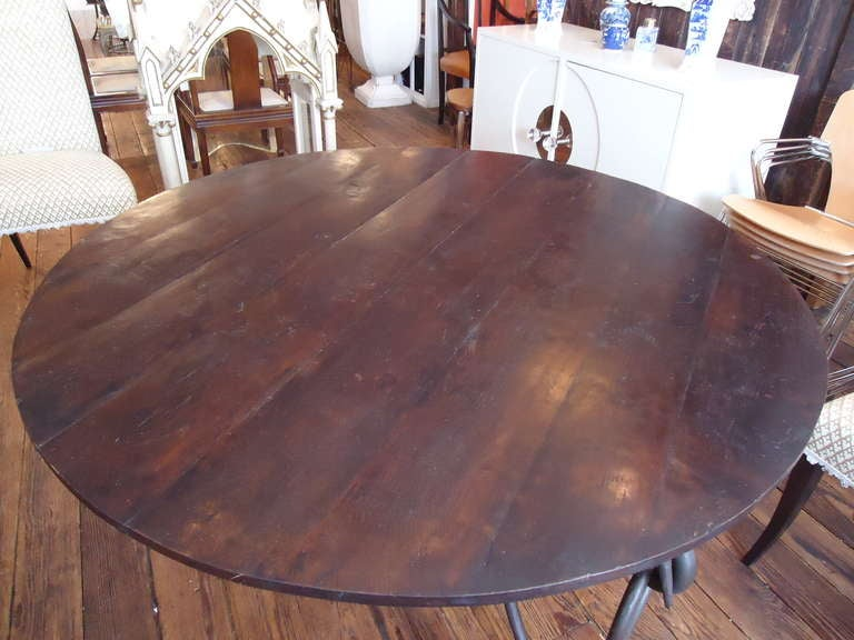 round rustic wood dining table on iron base at 1stdibs
