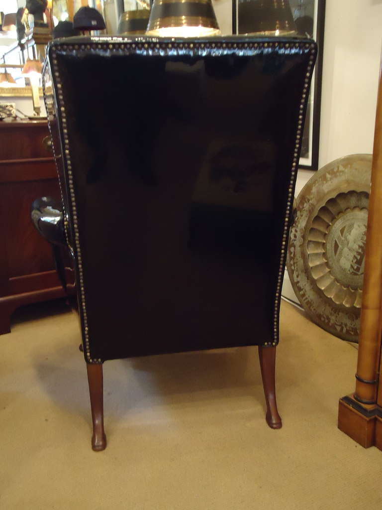 Sassy Black Patent Leather Wing Chair at 1stdibs