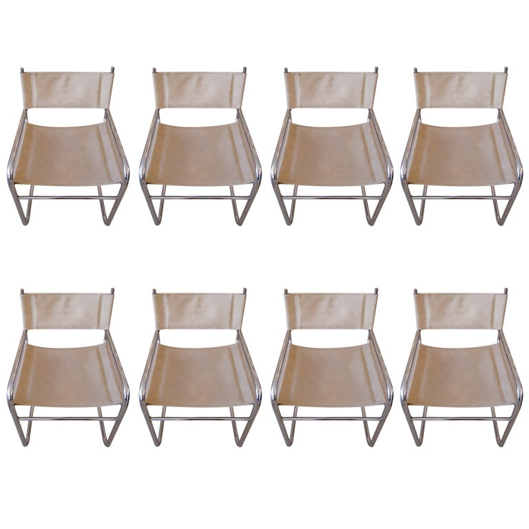 this eight ultra suede and chrome milo baughman dining chairs is no