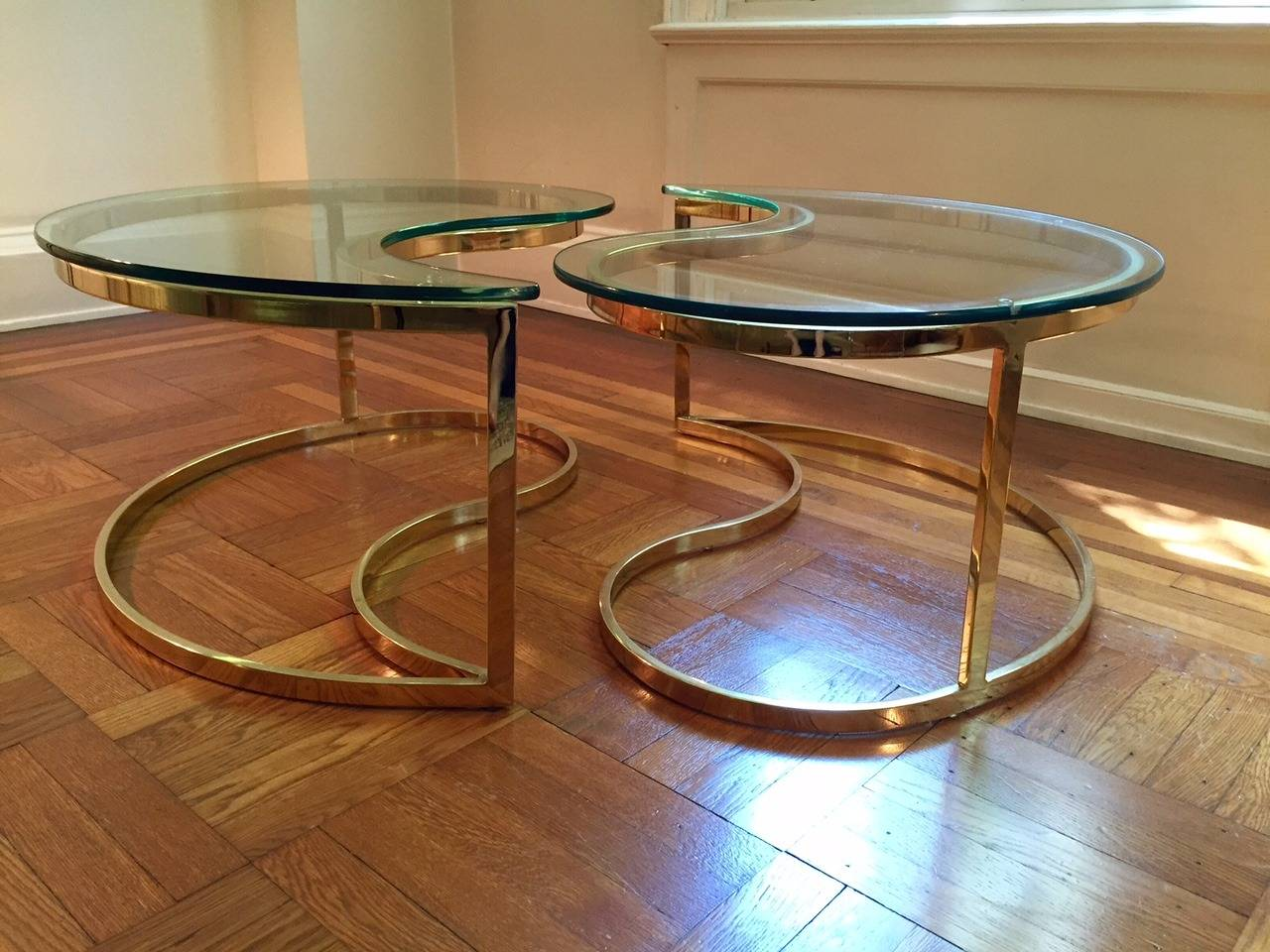 chic ying yang motiffe brass and glass coffee cocktail table for