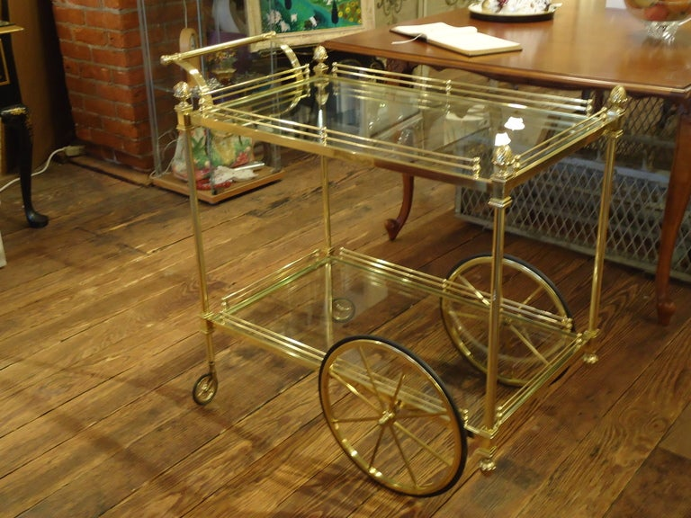 Elegant, simple Regency style bar or tea cart, brass with acorn decorative finials, two tier