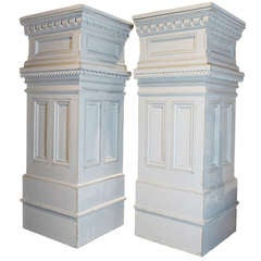 Pair of column form cabinets