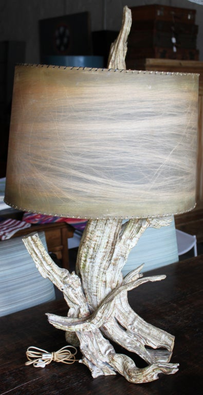 Mid-Century driftwood table lamp. Great form with polychromed finish. Original vellum shade with fiber and whip stitching to frame. Original driftwood finial. New wiring.